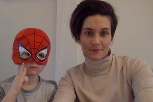 Heather and her son in a Spiderman mask